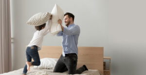father and child pillow fight